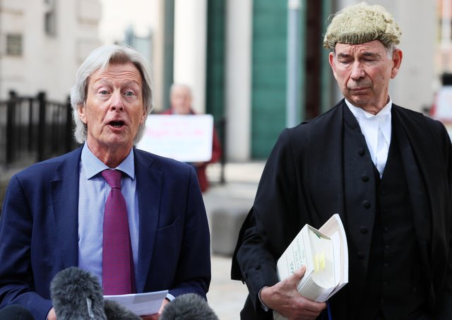 Arlene Foster's solicitor Paul Tweed (left) outside Belfast High Court following the defamation judgment on Thursday. Photo: Brian Lawless/PA Wire