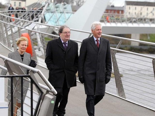 John and Pat Hume with President Bill Clinton cross the Peace Bridge