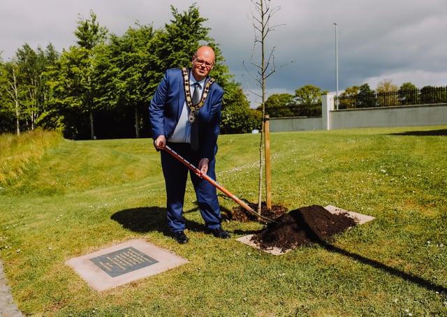 Mayor Cllr Jim Montgomery plants Covid memorials.