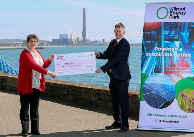 Ian Luney, commercial director of EP UK investments, presenting a cheque for £14,000 to Jackie McCaughey, MindWise area manager for housing support services.