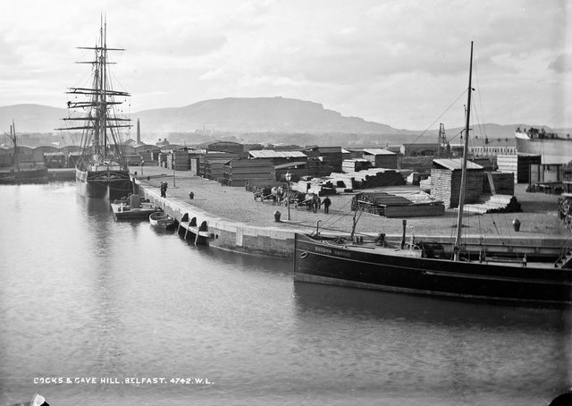 The docks in Belfast with the Bangor Castle tied to the quay and beautifully stacked timbers all around. The queue of horse carts with sacks of coal. NLI Ref: L_ROY_04742. Picture: National Library of Ireland