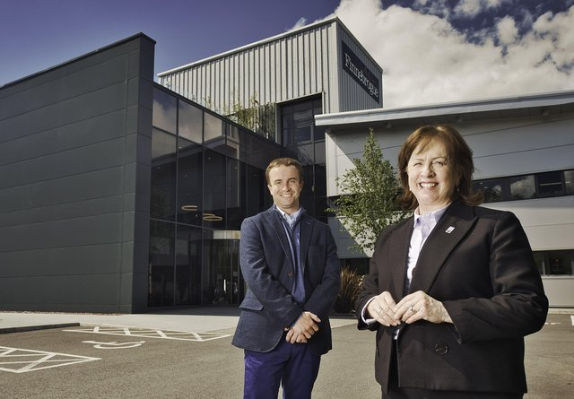 Minister Diane Dodds is greeted by Finnebrogue Artisan's Chief Strategic Officer Jago Pearson at the firm's headquarters