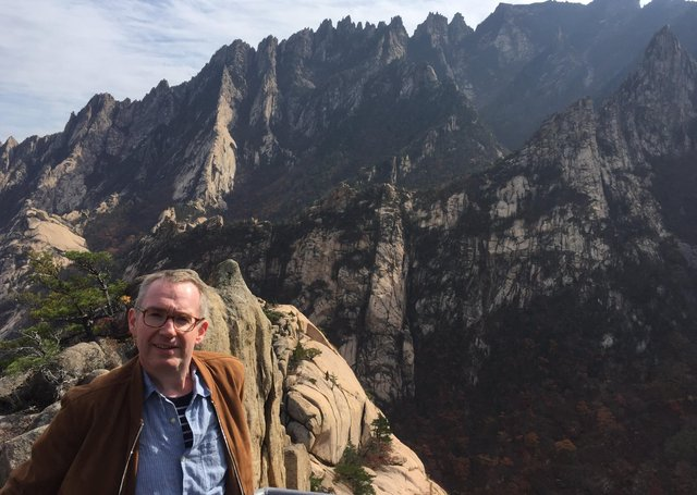 Colin Crooks, from Dungannon, in some of North Korea's rugged landscape during his time there