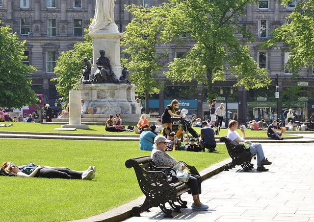 Sunseekers enjoy Sunday's good weather at Belfast City Hall