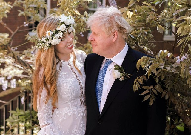 Handout photo of Prime Minister Boris Johnson and Carrie Johnson in the garden of 10 Downing Street after their wedding on Saturday