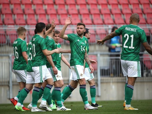 Gavin Whyte celebrates with his team-mates after scoring against Malta
