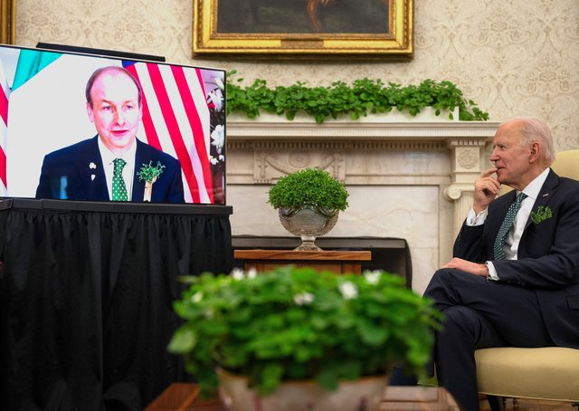 The Taoiseach Micheal Martin talks to Joe Biden on St Patrick's Day this year. However much the US president values his Irish roots, his corporate tax plan has gone down badly in the Republic of Ireland, where the rate is just 12.5%