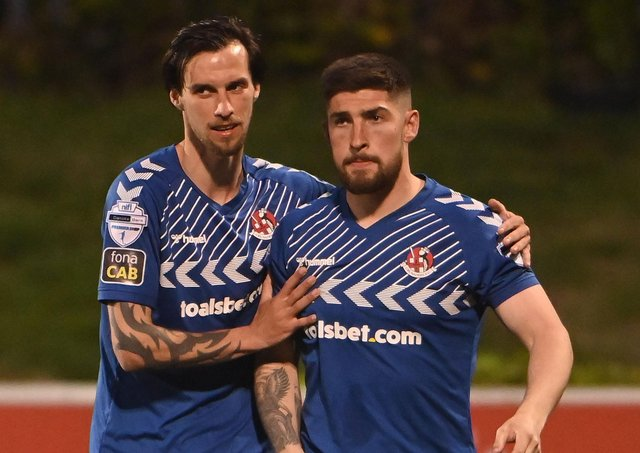 Michael Ruddy (right) is consoled by Crusaders team-mate Declan Caddell following Tuesday's penalty. Pic by PressEye Ltd.