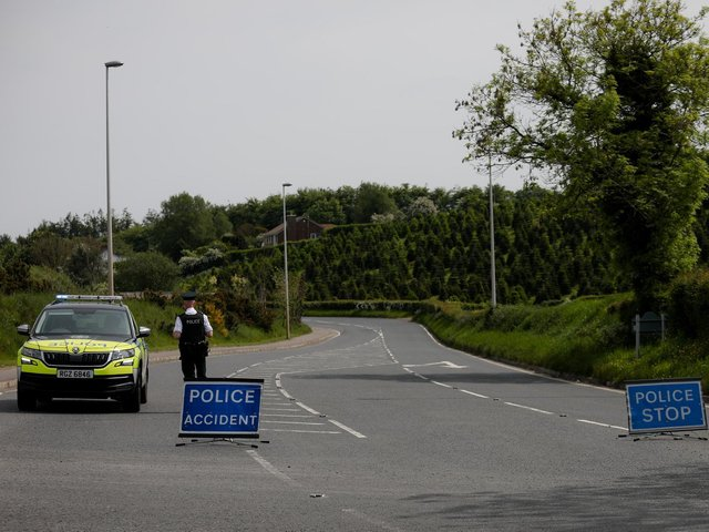 A PSNI officer pictured near the scene of the collision earlier on Tuesday.