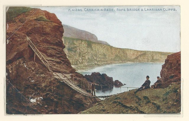 Old postcard of Carrick-a-Rede marking NI 100