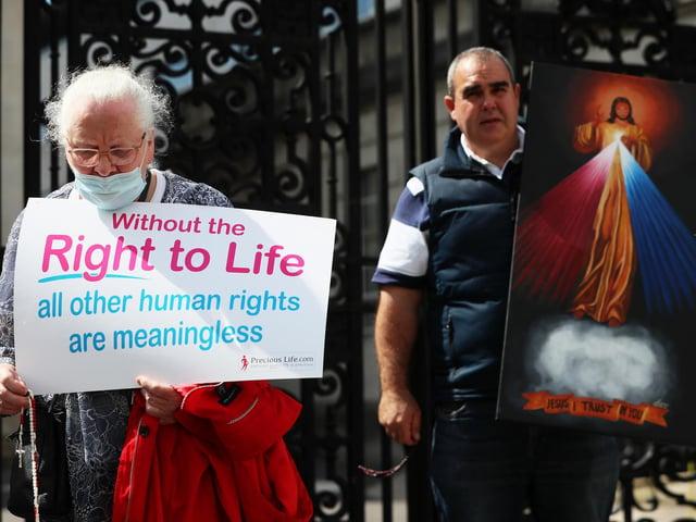 Anti abortion demonstrator prays outside Belfast High Court last month.