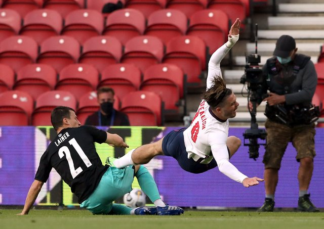 Austria's Stefan Lainer fouls England's Jack Grealish during the International Friendly match at The Riverside Stadium, Middlesbrough. P