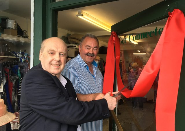 Journalist Paul Rooney cuts the ribbon on the new premises purchased by south Armagh peacemaker Ian Bothwell of Crossfire Trust in Crossmaglen.