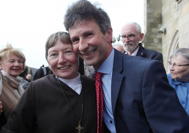 After making her first profession of vows in St Peter's Cathedral, west Belfast Sr Martina is greeted by the BBC Political Editor  Mark Devonport. Picture by Ann McManus