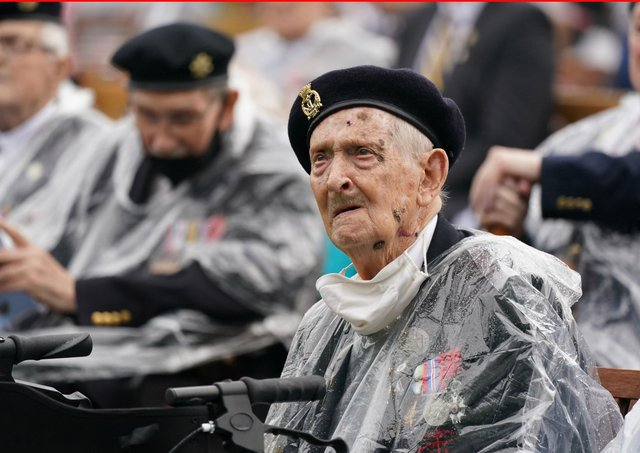 Veterans watch the official opening of the British Normandy Memorial in France via a live feed during a ceremony at the National Memorial Arboretum in Alrewas, Staffordshire. Photo:  Jacob King/PA Wire
