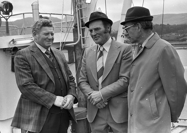 Mr Harold Bullock, right, chief executive of the NI Seed Potato Marketing Board, with Mr William Forsythe, a potato producer, and Mr Jay Semple, chairman of the UFU potato committee pictured  at Warrenpoint harbour at the end of April 1980. Picture: News Letter archives