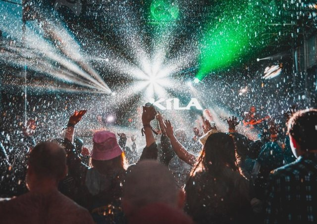 Crowds enjoy the atmosphere outdoors despite the rain at the Stendhal Festival in Co Londonderry in 2019