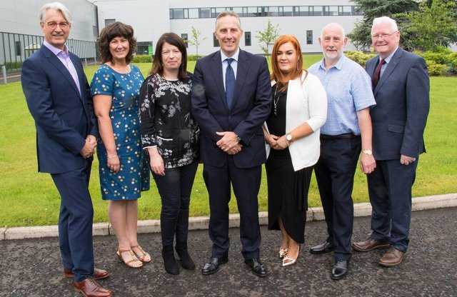 The current Board of The Gallaher Trust (LtoR) Mark Nodder OBE, Karen Reynolds, Jacqueline Williamson MBE, Ian Paisley MP, Anne Donaghy OBE, Pat McCallion and James Perry MBE