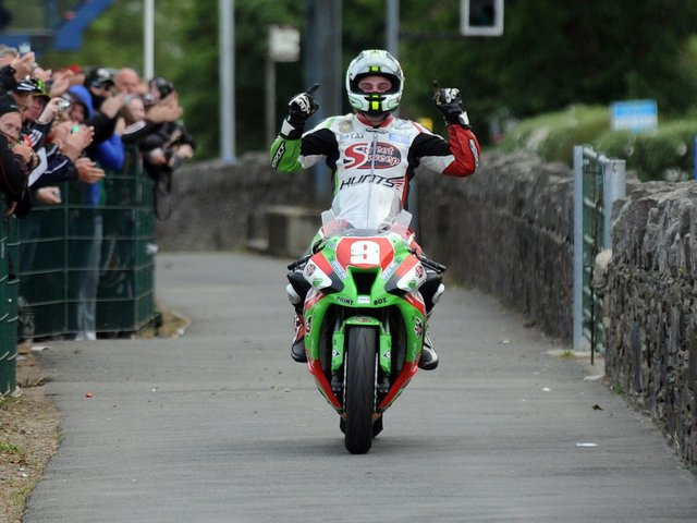Michael Dunlop celebrates victory in the 2011 Superstock TT on the MD Racing/Street Sweep Kawasaki ZX-10.