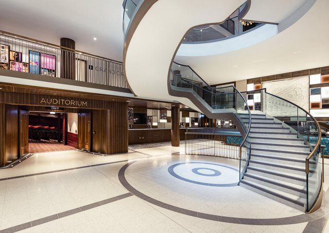 The helical staircase in the foyer of the Grand Opera House is designed to create drama before visitors even set foot in the auditorium