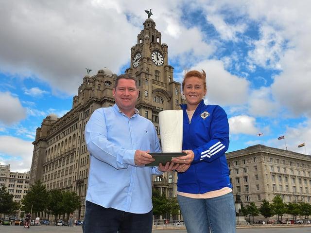 Rachel Furness is pictured receiving the award alongside Liverpool FC Women manager Matt Beard
