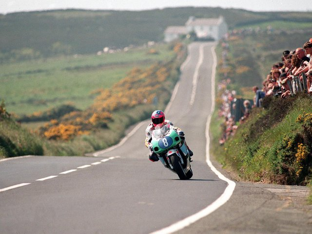 Can you name this famous Isle of Man TT rider and the year and corner where this picture was taken?