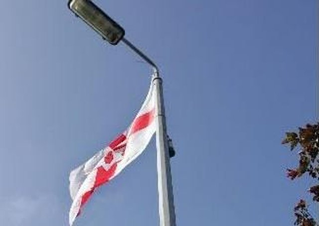 Calls for flags to be removed from town centres.
