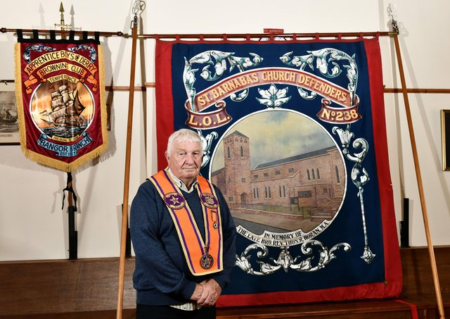 District Master of Bangor District LOL 18 Martyn McCready with an old Orange Lodge banner  that has been recently recovered from an attic in Dublin.  Pic Colm Lenaghan/Pacemaker