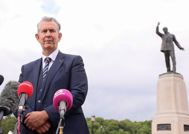 DUP leader Edwin Poots speaks to the press at Carson's statue in the grounds of Stormont. Picture by Jonathan Porter/PressEye