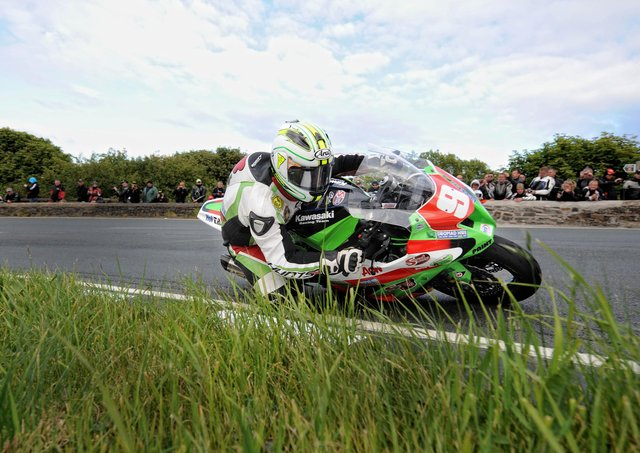 Michael Dunlop rounds the Gooseneck on his way to winning the 2011 Superstock race at the Isle of Man TT.