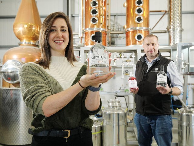 Emma Swan, Asda's Buying Manager for NI local with David Boyd-Armstrong, Head Distiller and co-founder of Rademon Estate Distillery who have secured a contract to supply two new gin products to Asda stores across Northern Ireland