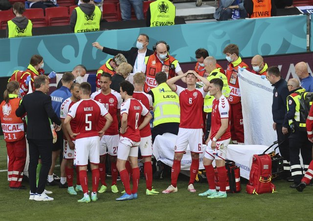 Denmark's players react as their team-mate Christian Eriksen receives treatment during the Euro 2020 match with Finland in Copenhagen on Saturday. Pic by PA.