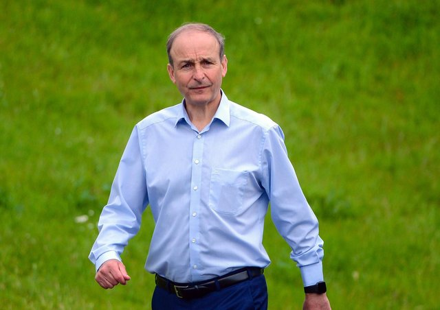 Taoiseach Micheal Martin seen in relaxed form as he took an early morning stroll at Lough Erne Resort ahead of the British-Irish Council summit on Friday.  Picture: McGrade/Pacemaker Press
