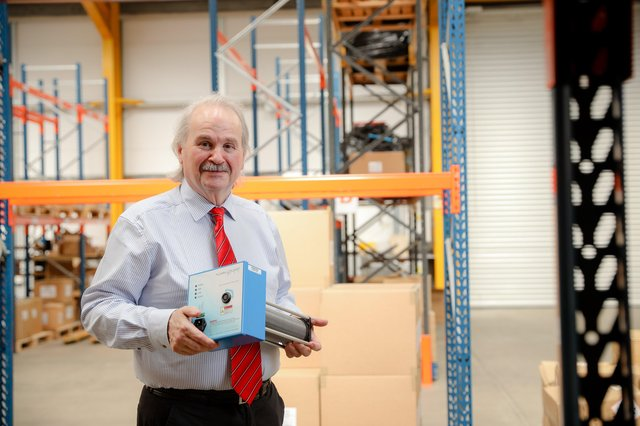 Irwin Armstrong, CEO of CIGA Healthcare, holding the Plasmaguard PRO clean air device