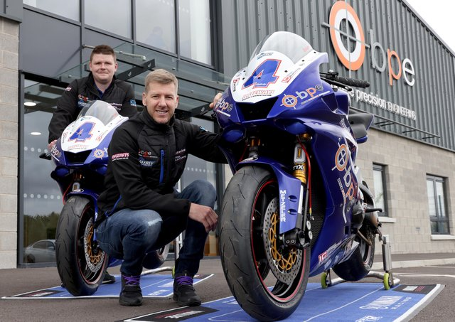 Ian Hutchinson with Alister Russell, team principal, Boyce Precision Engineering by Russell Racing, and the Yamaha YZF-R6 he will race in the Supersport class at the major road races in 2022. PICTURE: STEPHEN DAVISON.