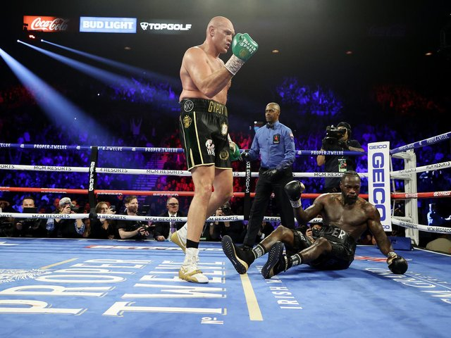 Tyson Fury knocks down Deontay Wilder in the fifth round during their Heavyweight bout in Las Vegas on February 22, 2020