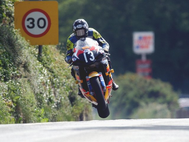 Can you name this TT rider, the section of the course and the year this picture was taken?