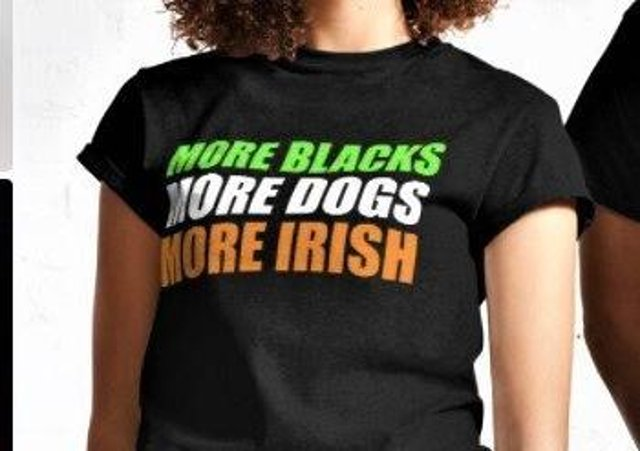 Models for the retailer Redbubble posing with a 'More Blacks, More Dogs, More Irish' t-shirt, popularly worn by self-described anti-racists; Ruth Dudley Edwards however questions whether the slogan which the t-shirt is denouncing (No Blacks, No Dogs, No Irish) ever in fact existed in real life