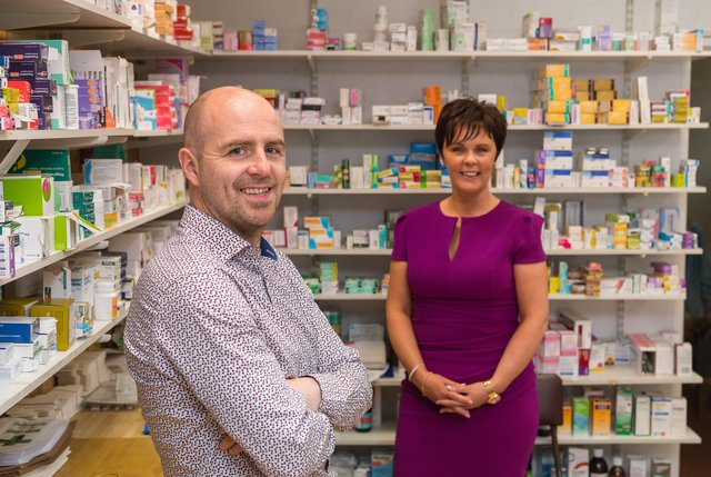 Declan Campbell of Campbell's Pharmacy, Maguiresbridge with Caroline O'Hagan, Client Business Manager, Danske Bank.  Picture: Ronan McGrade