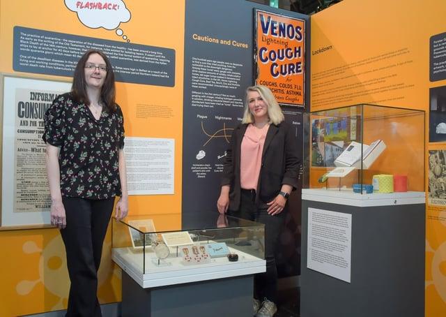 Dr Karen Logan with EastSide Partnership's heritage officer Lisa Rea Currie at their community display