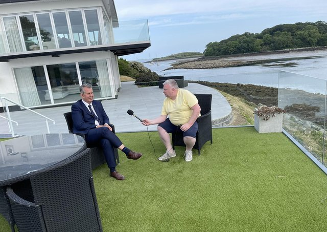 Edwin Poots being interviewed by Stephen Nolan at the BBC presenter's home on the shore of Strangford Lough