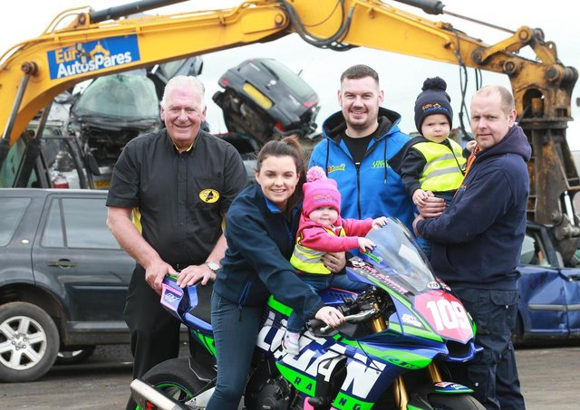 Armoy Clerk of the Course, Bill Kennedy MBE and road racer Neil Kernohan pictured with Martin and Nicole Laverty, Euro Autospares Limited - sponsors of the Open Superbike race - and their children, Clodagh and Caidan.