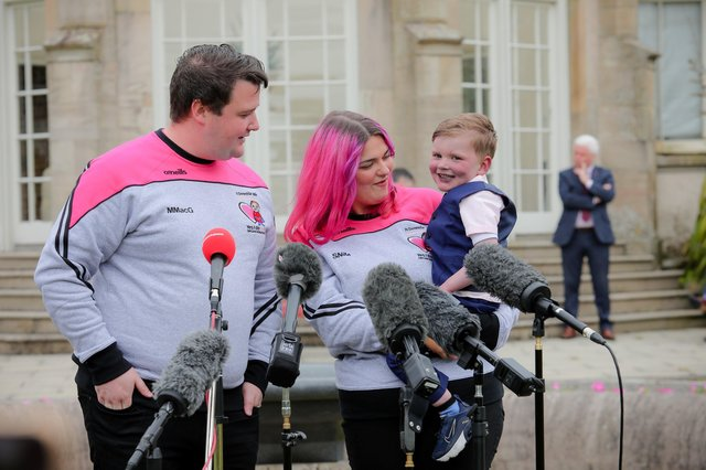 """Daithi MacGabhann, with father Mairtin and his partner Seph Ni Mheallain, at Stormont Castle. The father of the four-year-old boy who needs a new heart has hailed an """"emotional day"""" after Stormont leaders agreed to progress a long-awaited law on opt-out organ donation in Northern Ireland."""