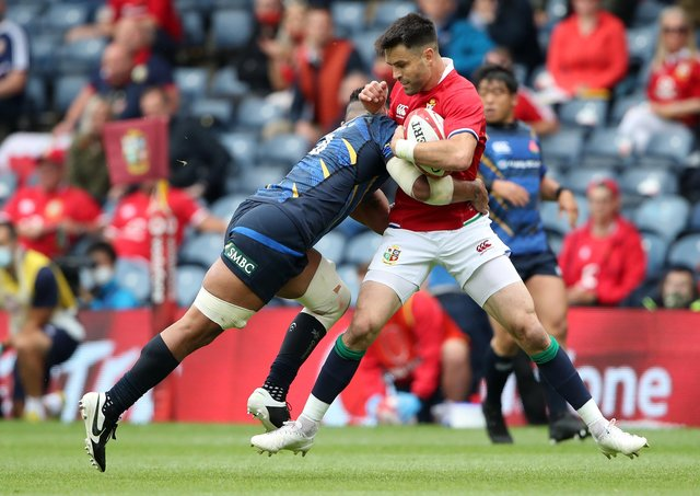 Conor Murray of the Lions is tackled by Amanaki Lelei Mafi of Japan during the 1888 Cup match between the British & Irish Lions and Japan at BT Murrayfield Stadium on June 26, 2021 in Edinburgh, Scotland. (Photo by Ian MacNicol/Getty Images)