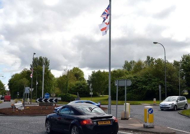 Flags have been erected on lamposts at the Craigavon Area Hospital roundabout.