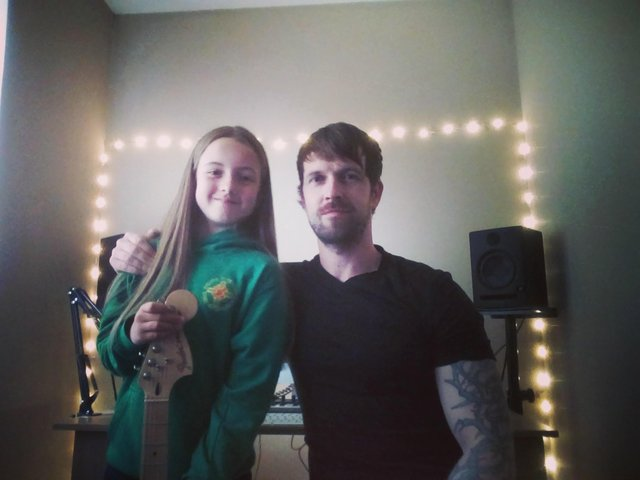 Larne singer-songwriter Martin Connon and his daughter Amber.