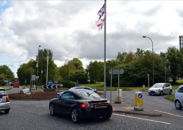Union flags at the roundabout at the entrance to Craigavon Hospital.