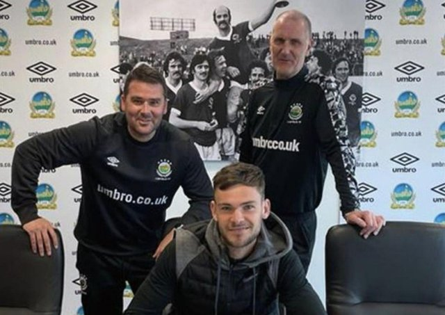 Jack Ruddy signs on at Windsor Park. Picture by Linfield FC