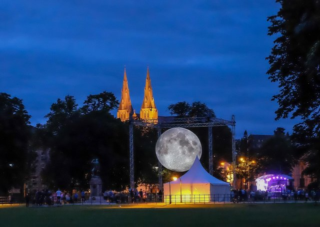 Crowds gather at dusk to view the Museum of the Moon the scale representation of the moon on The Mall, Armagh in July 2019.  Credit: www.LiamMcArdle.com
