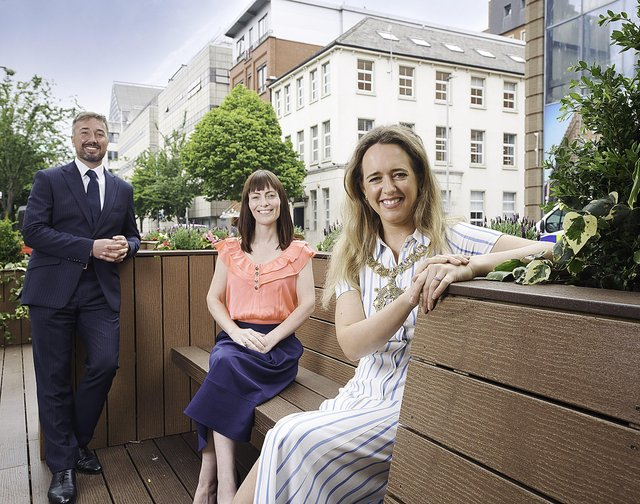 Pictured at the launch of Belfast city's first parklet on Linenhall Street are Chris McCracken, MD of LQ BID, Lord Mayor Cllr Kate Nicholl and Minister for Infrastructure Nichola Mallon MLA